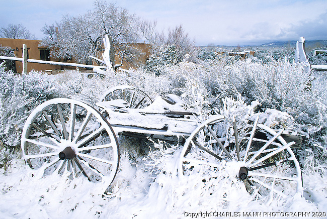 An old wagon makes a romatic compositon when covered with snow in Santa Fe, New Mexico