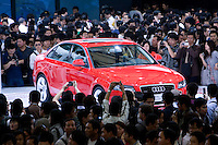 SHANGHAI, CHINA - April 25: Visitors admire an Audi car at Shanghai Motor Show on April 25, 2009 in Shanghai, China. Shanghai auto show opened Monday for the press and will be open April 24-28 for the public. China is the only major auto market still growing despite the global economic slowdown. U.S. and global auto makers see China as the place where they can find the sales they desperately lack in their home market. Chinese automakers see the opportunity to assess themselves as major players in the world market. (Photo by Lucas Schifres/Getty Images)