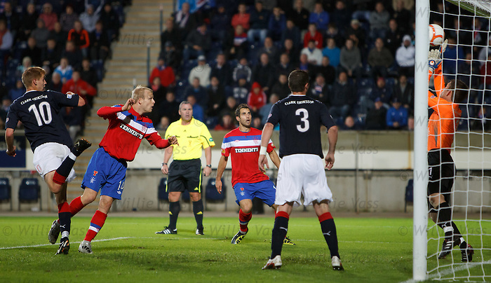 Falkirk keeper Michael McGovern saves from Steven Naismith's header
