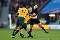 Nehe Milner-Skudder of New Zealand is tackled in possession. Rugby World Cup Final between New Zealand and Australia on October 31, 2015 at Twickenham Stadium in London, England. Photo by: Patrick Khachfe / Onside Images