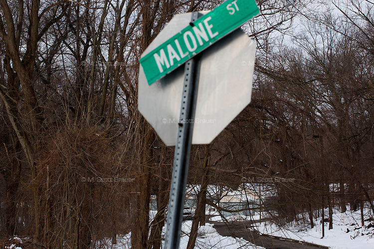 A road leads to the residences in Malone Park at the Fernald Developmental Center in Waltham, Massachusetts, USA, which house 13 people with severe mental disabilities.