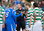 St Johnstone v Celtic.....12.04.11.Ref Iain Brines gets between Graham Gartland and Glenn Loovens.Picture by Graeme Hart..Copyright Perthshire Picture Agency.Tel: 01738 623350  Mobile: 07990 594431