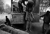 Kabul, Afghanistan<br /> November 2001<br /> <br /> The United Nations distributes coal and food.
