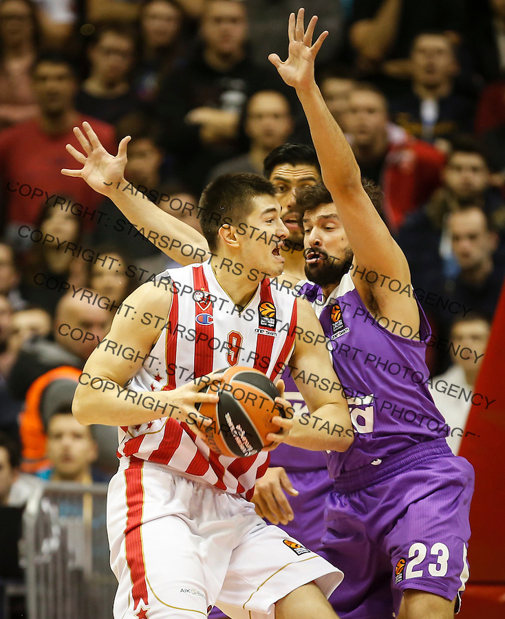 BELGRADE, SERBIA - DECEMBER 22: Luka Mitrovic (L) of Crvena Zvezda in action against Sergio Llull (R) of Real Madrid during the 2016/2017 Turkish Airlines EuroLeague Regular Season Round 14 game between Crvena Zvezda MTS Belgrade and Real Madrid at Aleksandar Nikolic Hall on December 22, 2016 in Belgrade, Serbia. (Photo by Srdjan Stevanovic/Getty Images)