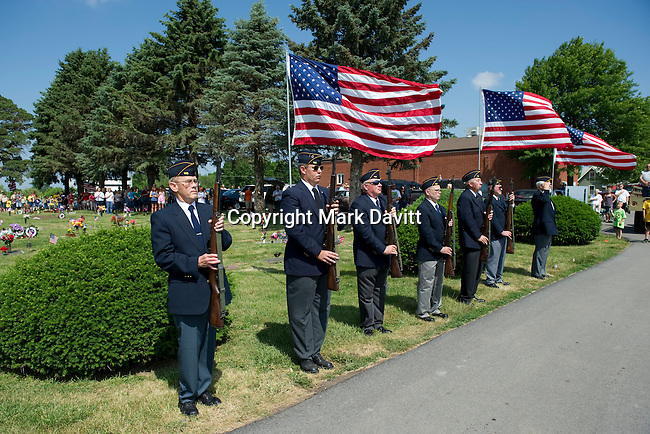 Members of the American Legion Post 165, from left, Darwin Brown, Luke Peters, Bill Hon, Jesse Tom, Gary Denniston, Eldon Chittenden and Bob Evans stand at attention while Taps was played.