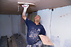 Man plastering the ceiling,
