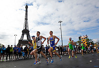 09 JUL 2011 - PARIS, FRA - Brad Kahlefeldt (Les Sables Vendee Tri) (second from left) leads Kris Gemmell (St Jean de Monts Vendee Tri) (left) and Gregory Rouault (Poissy Triathlon) on the run during the men's French Grand Prix series race (PHOTO (C) NIGEL FARROW)