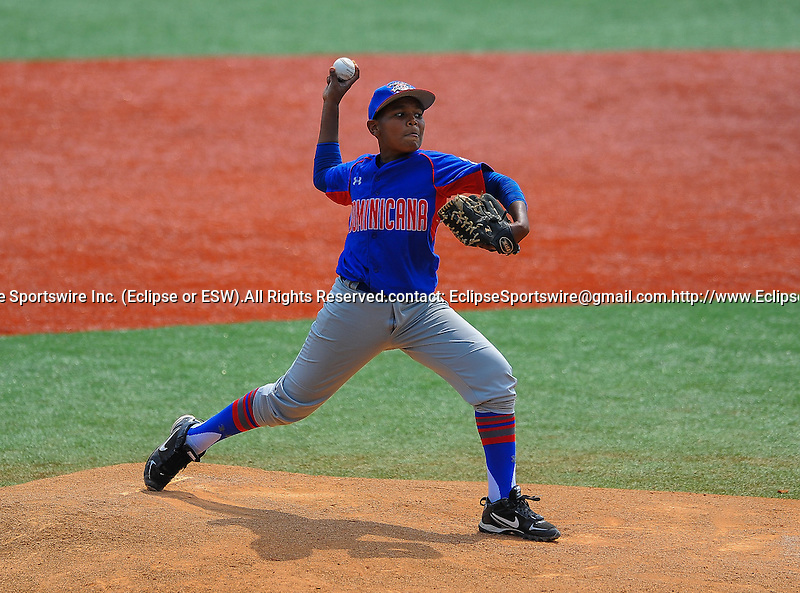 Dominican Republic's Jason Ferreras pitches during the Cal Ripken Babe Ruth World Series in Aberdeen, Maryland on August 17, 2012. The Republic of Korea defeated the Dominican Republic 7-3 to advance to the International Championship on Saturday.