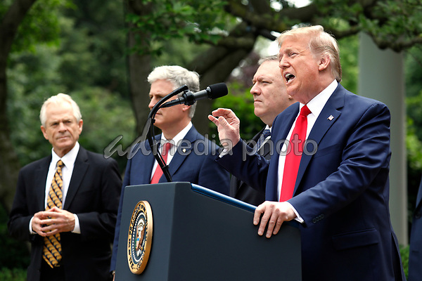 United States President Donald J. Trump delivers remarks on China in the Rose Garden at the White House in Washington, DC on May 29, 2020. Pictured from left to right; Peter Navarro, Director of Trade and Industrial Policy and Director of the White House National Trade Council; US National Security Advisor Robert C. O'Brien; US Secretary of State Mike Pompeo; and the president.<br /> Credit: Yuri Gripas / Pool via CNP/AdMedia