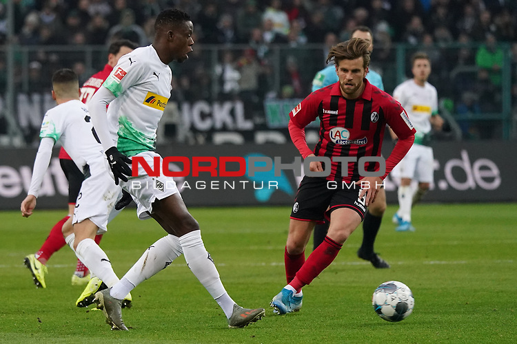 01.12.2019, Borussia Park , Moenchengladbach, GER, 1. FBL,  Borussia Moenchengladbach vs. SC Freiburg,<br />  <br /> DFL regulations prohibit any use of photographs as image sequences and/or quasi-video<br /> <br /> im Bild / picture shows: <br /> Denis Zakaria (Gladbach #8), im Zweikampf gegen  Lucas Höler / Hoeler (Freiburg #9), <br /> <br /> Foto © nordphoto / Meuter