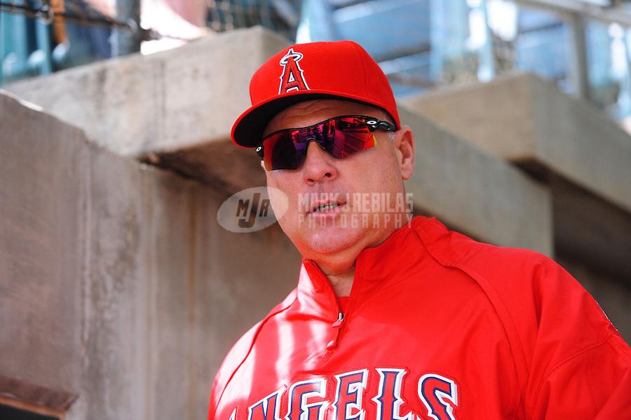 Mar. 4, 2012; Phoenix, AZ, USA; Los Angeles Angels manager Mike Scioscia against the Oakland Athletics during a spring training game at Phoenix Municipal Stadium.  Mandatory Credit: Mark J. Rebilas-