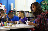 Malia Obama participates in a community service project at the Boys & Girls Club of Greater Washington, DC in celebration of the Martin Luther King, Jr. Day of Service, in Washington, D.C., Monday, January 19, 2015.<br /> Credit: Martin H. Simon / Pool via CNP
