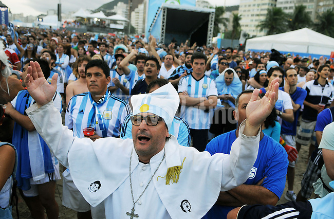 Argentina supporter imitates Pope Francis during a live broadcast of the soccer World Cup semifinal match between Argentina and Netherlands, inside the FIFA Fan Fest area on Copacabana beach,  Rio de Janeiro, Brazil, July 09, 2014