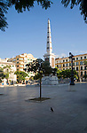 Obelisk in the historic, Plaza de la Merced, city of Malaga, Spain