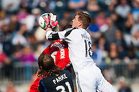 Philadelphia Union goalkeeper Zac MacMath (18) grabs a pass intended for Gale Agbossoumonde (6) of Toronto FC. during a Major League Soccer (MLS) match at PPL Park in Chester, PA, on April13, 2013.