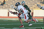 Redondo Beach, CA 05/11/10 - Zack Henkhaus (PV # 12) and Unknown Mira Costa player in action during the 2010 Los Angeles Boys Lacrosse championship game, Mira Costa defeated Palos Verdes 12-10 at Redondo Union High School.