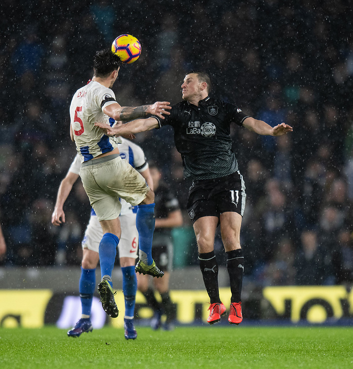 Burnley's Chris Wood (right) battles with Brighton & Hove Albion's Lewis Dunk (left) <br /> <br /> Photographer David Horton/CameraSport<br /> <br /> The Premier League - Brighton and Hove Albion v Burnley - Saturday 9th February 2019 - The Amex Stadium - Brighton<br /> <br /> World Copyright © 2019 CameraSport. All rights reserved. 43 Linden Ave. Countesthorpe. Leicester. England. LE8 5PG - Tel: +44 (0) 116 277 4147 - admin@camerasport.com - www.camerasport.com