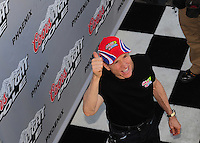 Apr 17, 2009; Avondale, AZ, USA; NASCAR Sprint Cup Series driver Mark Martin celebrates after winning the pole position for the Subway Fresh Fit 500 at Phoenix International Raceway. Mandatory Credit: Mark J. Rebilas-