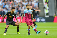 Jack Wilshere of West Ham United (right) during the Premier League match between West Ham United and Manchester City at the London Stadium, London, England on 10 August 2019. Photo by David Horn.