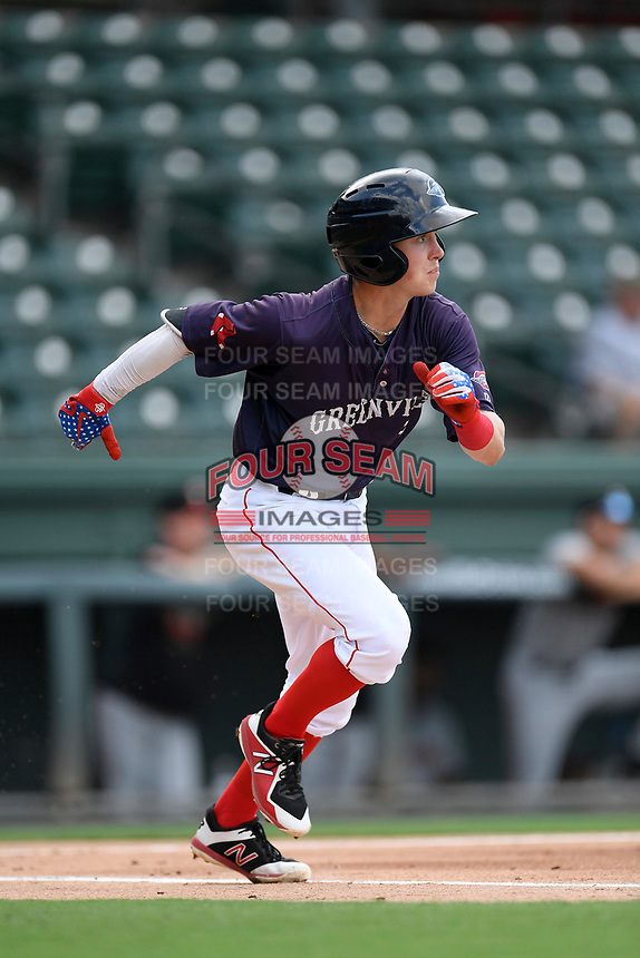 Shortstop Grant Williams (4) of the Greenville Drive runs out a batted ball in a game against the Delmarva Shorebirds on Friday, August 2, 2019, in the continuation of rain-shortened game begun August 1, at Fluor Field at the West End in Greenville, South Carolina. Delmarva won, 8-5. (Tom Priddy/Four Seam Images)