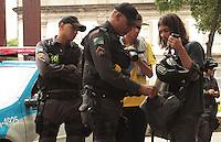 RIO DE JANEIRO, RJ, 12.12.2013 - ATO CONTRA CONDIÇÕES DA CIDADE E A PRISÃO DE MANIFESTANTES - O Manifestante e revistado pela policia antes do ato realizado ato pelo centro da contra a condição da cidade mediante o caos que se instalou na por conta da chuva de quarta feira e a prisão de manifestantes nessa quinta 12. (Foto: Levy Ribeiro / Brazil Photo Press)