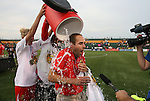 27 August 2011: New York head coach Aaran Lines (NZL) has a gatorade bucket full of ice water dumped on him after the game. Western New York Flash defeated the Philadelphia Independence 5-4 on penalty kicks to win the final after the game ended in a 1-1 tie after overtime at Sahlen's Stadium in Rochester, New York in the Women's Professional Soccer championship game.