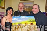 Mary Cronin, Martin Breen and Fr Kevin at the wine and art show in aid of Project Rombo Light of Maasai Kenya Killamanjaro trek charity in the Malton Hotel Killarney Friday night