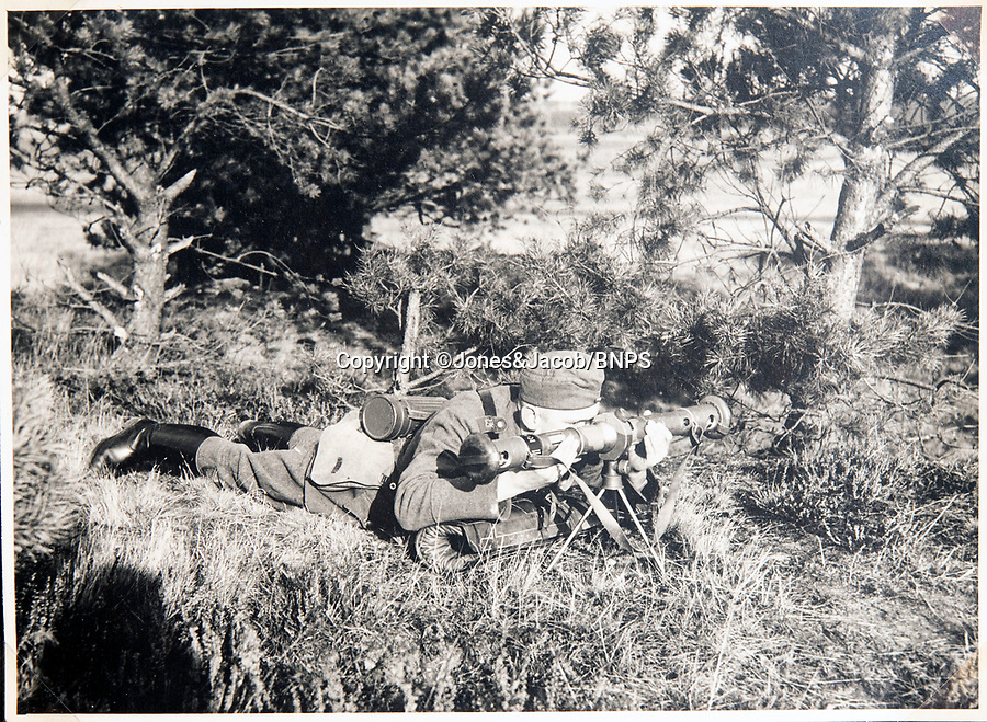 BNPS.co.uk (01202 558833)<br /> Pic: Jones&Jacob/BNPS<br /> <br /> Rangefinding on manouveres near Berlin.<br /> <br /> Springtime for Hitler...Chilling album of pictures taken by one of Hitlers bodyguards illustrates the Nazi dictators rise to power.<br /> <br /> An unseen album of photographs taken by a member of Hitlers own elite SS bodyguard division in the years leading up to the start of WW2.<br /> <br /> The 1st SS Panzer Division 'Leibstandarte SS Adolf Hitler' or LSSAH began as Adolf Hitler's personal bodyguard in the 1920's responsible for guarding the Führer's 'person, offices, and residences'.