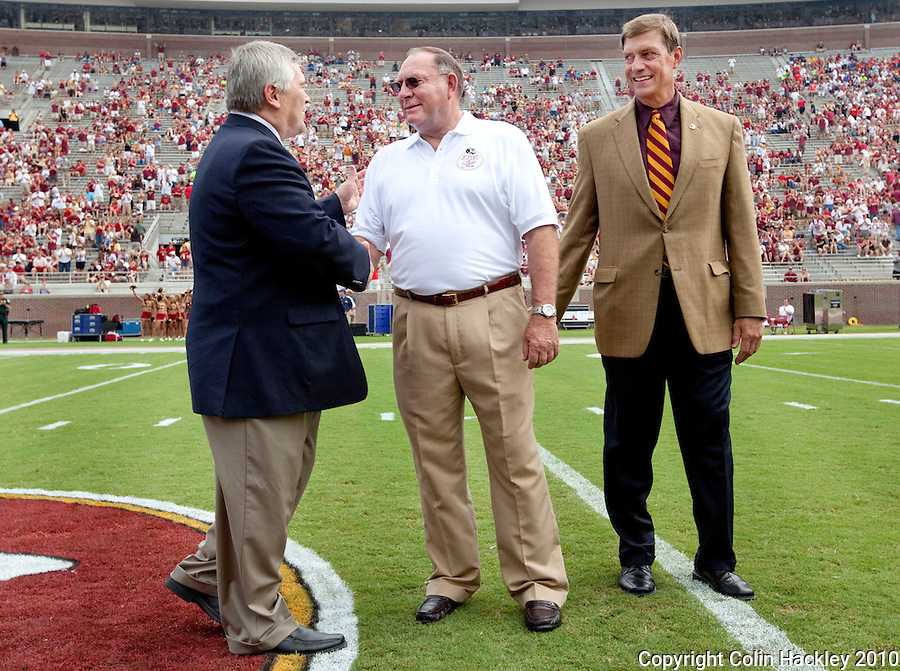 TALLAHASSEE, FL 9/4/10-FSU-SAMFORD FB10 CH-Former Florida State defensive coordinator Mickey Andrews, center, is congratulated by FSU President Eric Barron, left, and Athletic Director Randy Spetman prior to the Samford game Saturday at Doak Campbell Stadium in Tallahassee. .COLIN HACKLEY PHOTO