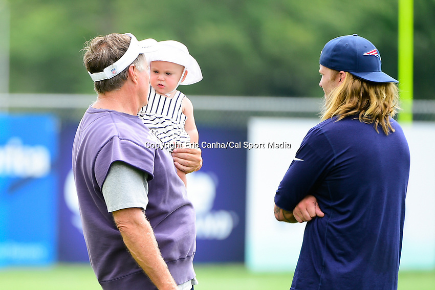 July 28, 2017: New England Patriots head coach Bill Belichick holds his granddaughter Blakely Rose Belichick, while talking to his son Steve at the New England Patriots training camp held at Gillette Stadium, in Foxborough, Massachusetts. Eric Canha/CSM
