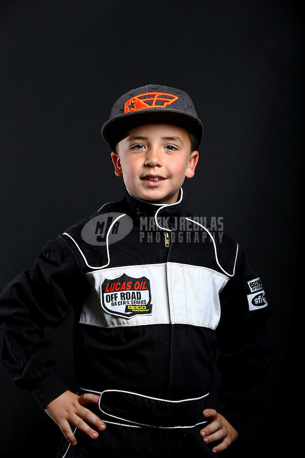 Mar. 21, 2014; Chandler, AZ, USA; LOORRS junior 2 driver Conner Barry poses for a portrait prior to round one at Wild Horse Motorsports Park. Mandatory Credit: Mark J. Rebilas-USA TODAY Sports