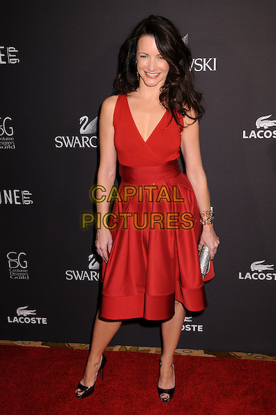KRISTIN DAVIS.11th Annual Costume Designers Guild Awards at the Four Seasons Beverly Wilshire Hotel, Beverly Hills, California, USA..February 17th, 2009.full length red dress black open toe shoes silver clutch bag.CAP/ADM/BP.©Byron Purvis/AdMedia/Capital Pictures.