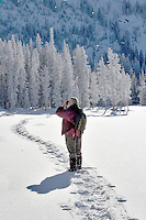 Snow shoer taking a picture at Anthony Lakes in winter
