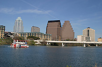 Visitors enjoy the sites while on a cruise on the beautiful blue waters of Lady Bird Lake in Austin, Texas.