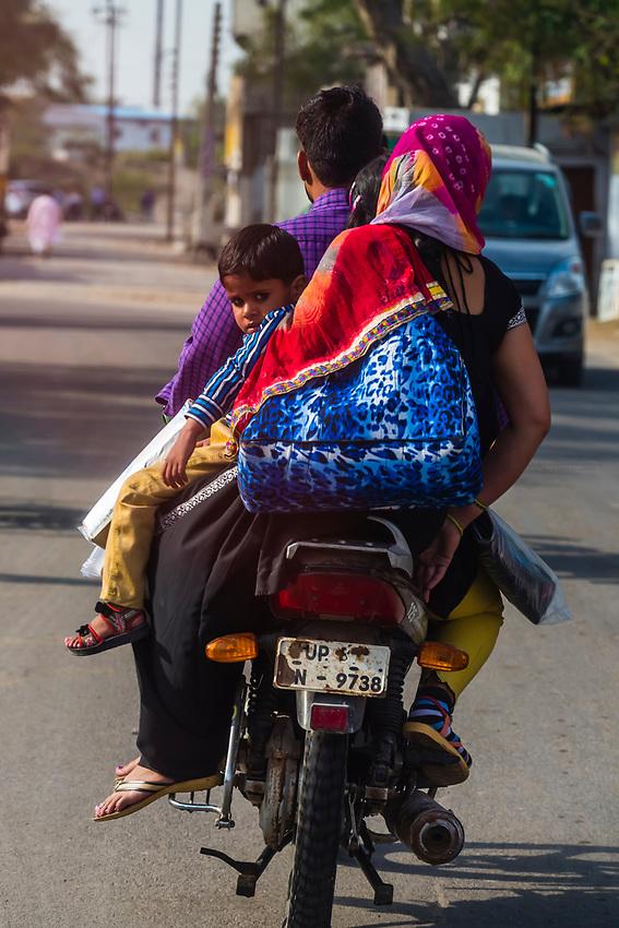 A family riding a motorcycle, Mathura, Uttar Pradesh, India.