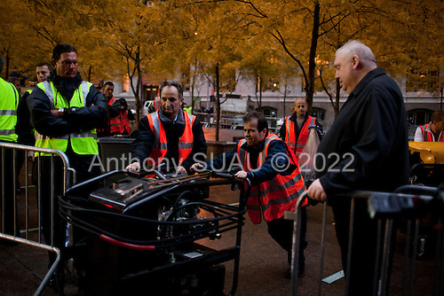 New York, New York<br /> November 15, 2011<br /> <br /> After the police clear Zuccotti Park workers clean the park as many of the evicted &quot;Occupy Wall Street&quot; protesters, reconvened in Foley Square.<br /> <br /> From there a group marched to Canal and 6th Ave and final back to Zuccotti Park to wait a court order to reenter the park.