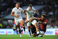 Jonny May of England is tackled by Morgan Parra and Sofiane Guitoune of France - 15/08/2015 - Twickenham Stadium - London <br /> Mandatory Credit: Rob Munro/Stewart Communications
