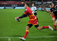 Gavin Henson of the Dragons escapes with the ball during the Guinness PRO14 match between Ospreys and Dragons at The Liberty Stadium, Swansea, Wales, UK. Friday 27 October 2017
