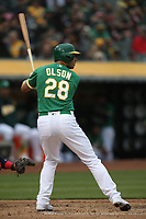 OAKLAND, CA - JUNE 15:  Matt Olson #28 of the Oakland Athletics bats against the Los Angeles Angels of Anaheim during the game at the Oakland Coliseum on Friday, June 15, 2018 in Oakland, California. (Photo by Brad Mangin)