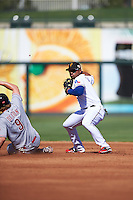 Surprise Saguaros Andy Ibanez (1), of the Texas Rangers organization, throws to first as Brandon Dixon (9) slides into second base during a game against the Peoria Javelinas on October 20, 2016 at Surprise Stadium in Surprise, Arizona.  Peoria defeated Surprise 6-4.  (Mike Janes/Four Seam Images)