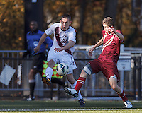 Virginia Tech forward Connor Pompilio (22) crosses the ball as Boston College defender Ryan Dunn (3) defends. Boston College (maroon) defeated Virginia Tech (Virginia Polytechnic Institute and State University) (white), 3-1, at Newton Campus Field, on November 3, 2013.