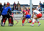 Mannheim, Germany, April 18: During the 1. Bundesliga Damen match between TSV Mannheim (white) and Mannheimer HC (red) on April 18, 2015 at TSV Mannheim in Mannheim, Germany. Final score 1-7 (1-4). (Photo by Dirk Markgraf / www.265-images.com) *** Local caption *** Friederike Schreiter #1 of TSV Mannheim, Lydia Haase #12 of Mannheimer HC, Viktoria Przybilla #15 of TSV Mannheim