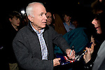 12 January 2007: US Senator and Republican Presidential candidate John McCain signs a campaign poster at a town hall meeting in Warren, Michigan, USA.