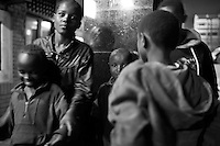 Sisters Christine Muthoni, 9, and Mary Njeri,14, beg on the streets of Westlands at night with other children in Naiorbi.