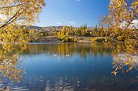 Autumn reflection on the Kawarau River at Bannockburn near Cromwell, Central Otago, New Zealand - stock photo, canvas, fine art print