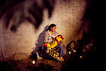 A mother and her child on All Souls Day in a cemetery in San Felipe del Agua, a small town outside of Oaxaca, Mexico Nov. 2, 2010.