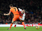 Arsenal's Jack Wilshere gets fouled by Liverpool's James Milner during the premier league match at the Emirates Stadium, London. Picture date 22nd December 2017. Picture credit should read: David Klein/Sportimage