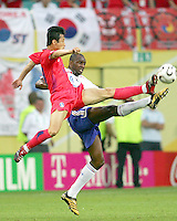 Eul Yong Lee (13) of Korea beats Patrick Veira (4) of France to the ball.The Korea Republic and France played to a 1-1 tie in their FIFA World Cup Group G match at the Zentralstadion, Leipzig, Germany, June 18, 2006.