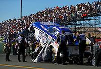 Jul. 26, 2013; Sonoma, CA, USA: NHRA crew members for funny car driver Robert Hight during qualifying for the Sonoma Nationals at Sonoma Raceway. Mandatory Credit: Mark J. Rebilas-