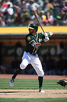 OAKLAND, CA - JUNE 30:  Dustin Fowler #11 of the Oakland Athletics bats against the Cleveland Indians during the game at the Oakland Coliseum on Saturday, June 30, 2018 in Oakland, California. (Photo by Brad Mangin)